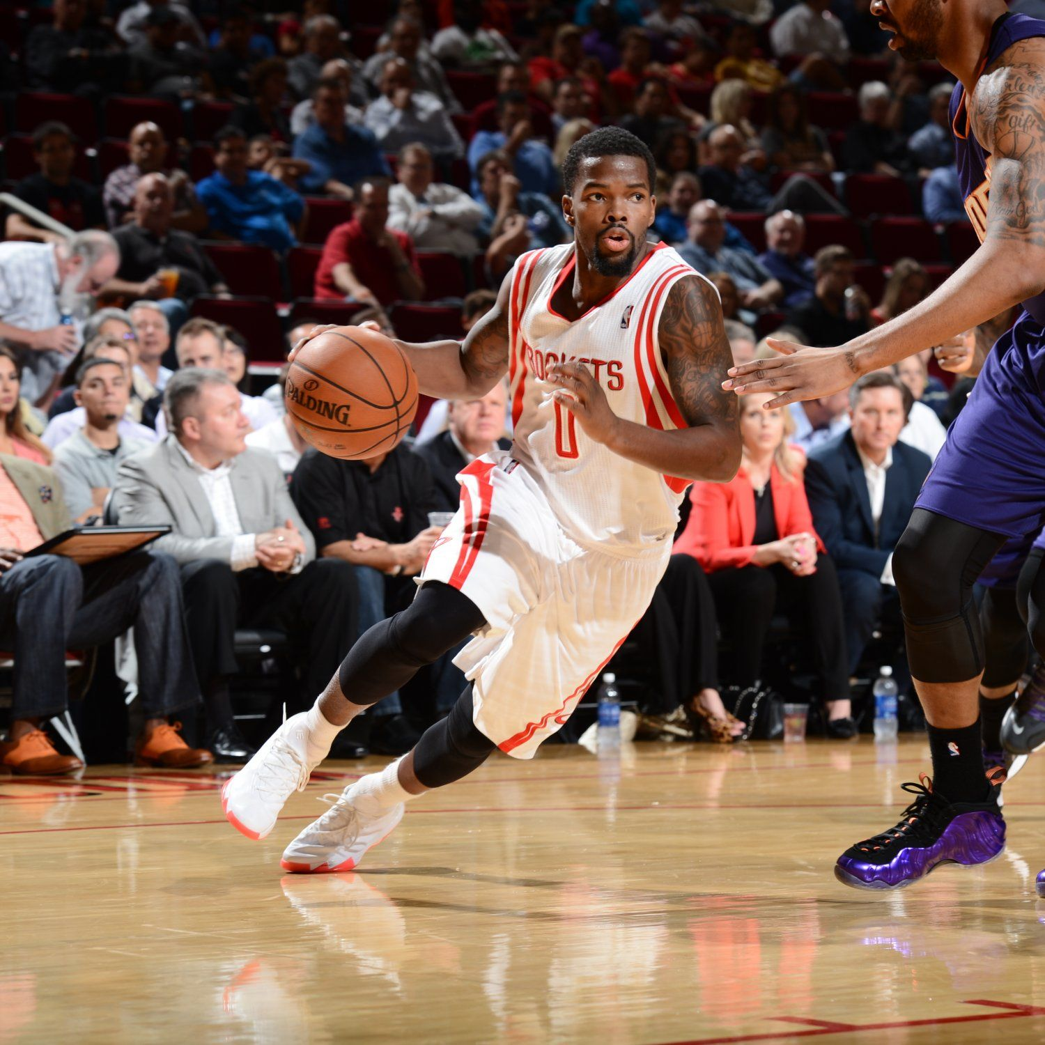 hi-res-453621695-aaron-brooks-of-the-houston-rockets-drives-to-the_crop_exact