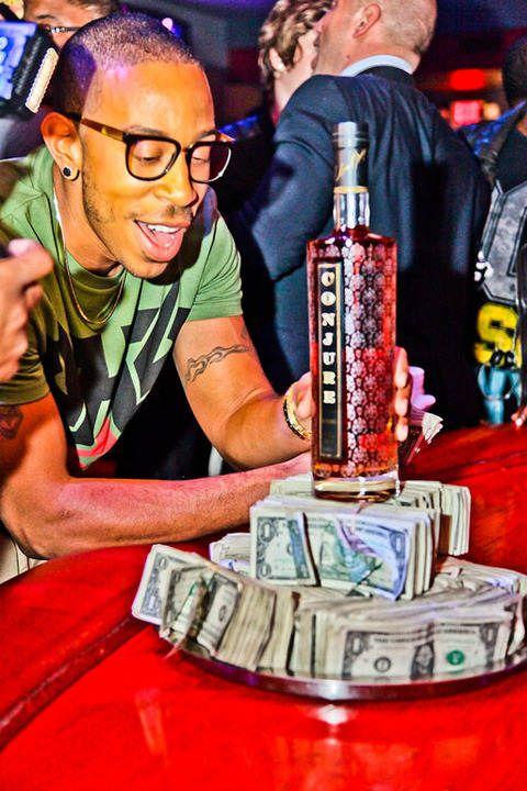 luda partying in a strip club