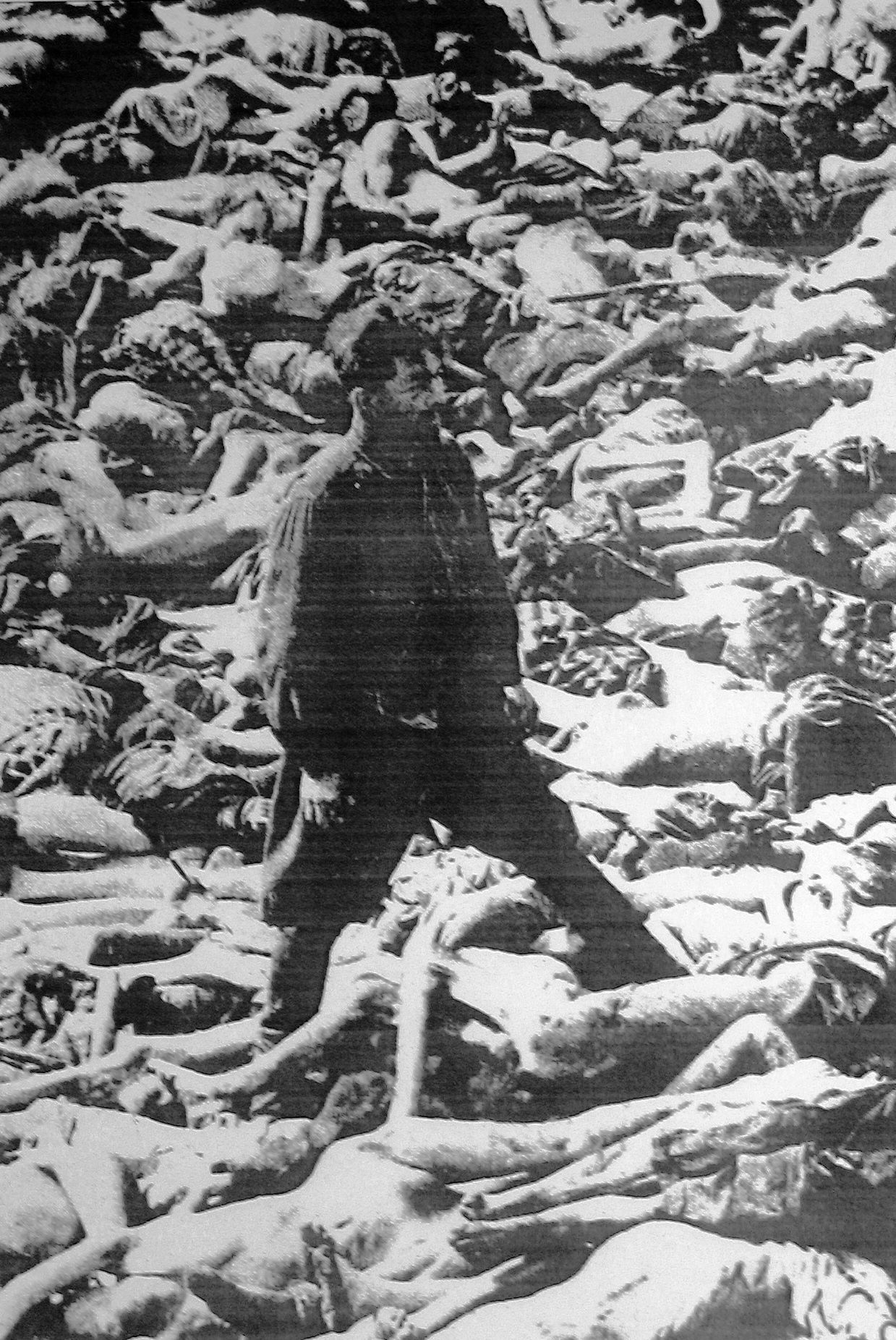 Dr Fritz Klein Stands in a Mass Grave in Belsen