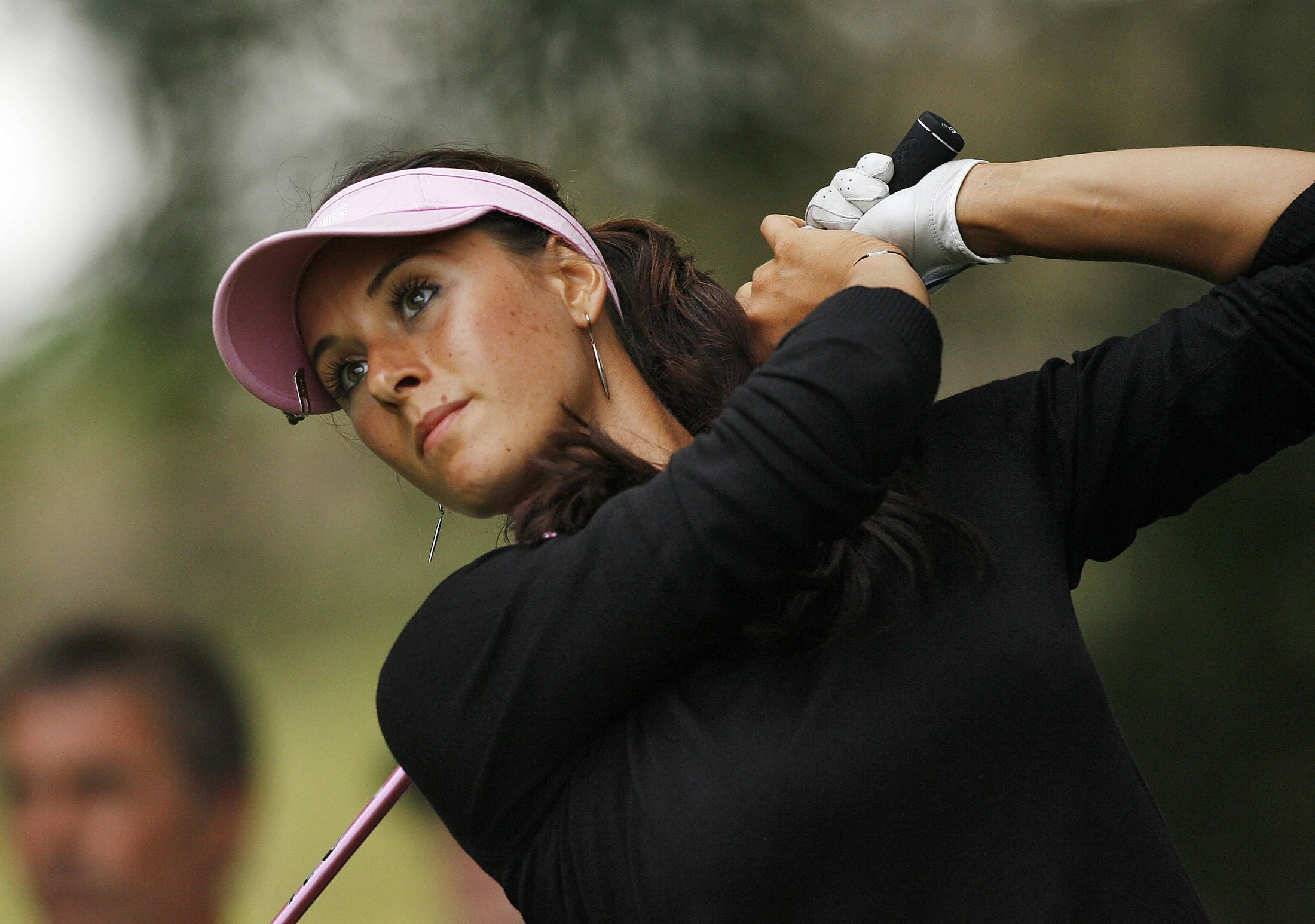 Russian golfer Maria Verchenova watches